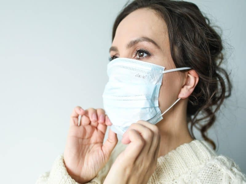 Canva Woman in White Face Mask 1